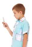 Young boy send text message with phone Stock Image