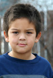 Young Boy Serious. Portrait of a young boy with a serious expression on his face Stock Photo