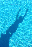 Young boy shadow diving in the swimming pool Stock Photography