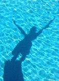 Young boy shadow diving in the swimming pool Royalty Free Stock Photos