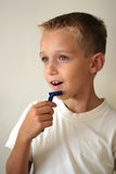 Young boy shaving Stock Photo