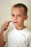 Young boy shaving Stock Photography