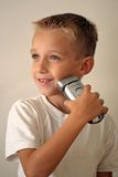 Young boy shaving Royalty Free Stock Photos