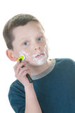 Young boy shaving Stock Images