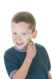 Young boy shaving Royalty Free Stock Images