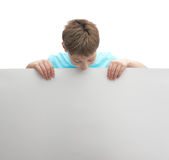 Young boy with a sheet of paper Royalty Free Stock Image