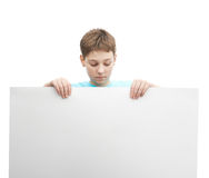 Young boy with a sheet of paper Stock Image