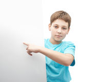 Young boy with a sheet of paper Royalty Free Stock Images