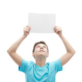 Young boy with a sheet of paper Stock Photo