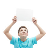 Young boy with a sheet of paper Stock Images