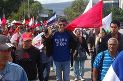 Protest March against reelection 2017 8. Young Boy with a shirt wih the fuea JOH sign in a march in Honduras Stock Image