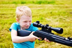 Young boy shooting Royalty Free Stock Photos