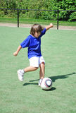 Young boy shooting ball. Young boy shooting soccer ball Stock Photos
