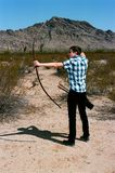 Young boy shooting a bow and arrow Stock Image