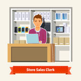 Young boy shop assistant Royalty Free Stock Photo