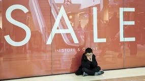 Young boy shopping stock photo