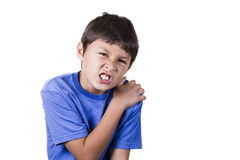 Young boy with shoulder pain. On white background Stock Photo