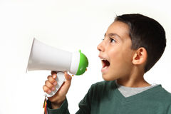 Young boy shout in megaphone. Kid yelling through a megaphone on white background Stock Images