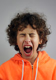 Young boy is shouting. Young boy is in a shouting gesture Stock Images