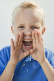 Young Boy Shouting. Portrait of a young boy shouting isolated over white background Royalty Free Stock Photo