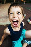 Young boy shouting Stock Images