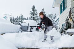 Young boy shoveling snow Stock Photo