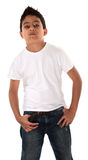 Young Boy Showing Attitude. Young Hispanic child in t-shirt and hands pockets with an attitude Stock Photo