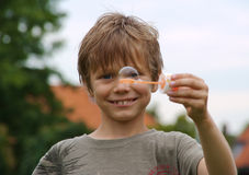Young boy Showing Bubble Wand Stock Image