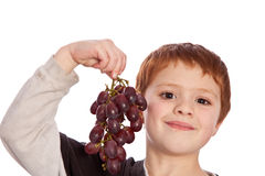 Young boy showing fresh grapes Royalty Free Stock Photos
