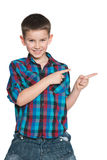 Young boy showing his fingers aside Royalty Free Stock Photography