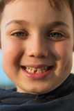 Young boy showing his first missing tooth Stock Photo
