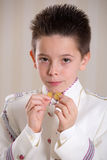 Young boy showing his medals in his First Holy Communion Stock Photography
