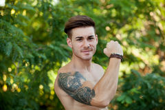 Young boy with showing his muscles. Stock Photo