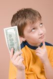 Young boy showing money Stock Photography