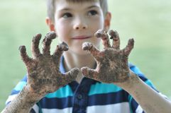 A young boy showing off his dirty hands royalty free stock photos