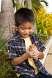 Young boy showing off his pet hamster Royalty Free Stock Image