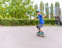Young boy showing off on his skateboard Stock Photography
