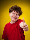 Young boy showing OK sign Royalty Free Stock Photography