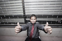Young boy showing thumbs up Stock Image