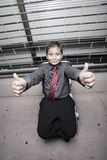 Young boy showing thumbs up Royalty Free Stock Photos