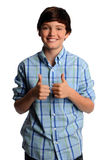 Young Boy Showing the Thumbs Up Royalty Free Stock Photography