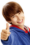 Young boy showing a thumbs up stock image
