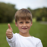Young boy showing thumbs up Royalty Free Stock Photography