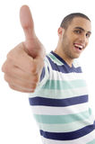 Young boy showing thumbs up stock images