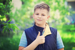Young Boy Showing Thumbs Up Gesture. Outdoors Stock Photos