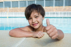 Young boy showing thumbs up at poolside Royalty Free Stock Images