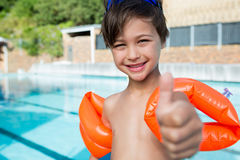 Young boy showing thumbs up at poolside Royalty Free Stock Image
