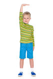 Young boy shows how he is tall Stock Photo