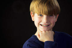 A Young Boy Shows off his Green Braces Royalty Free Stock Photos