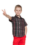 Young boy shows victory sign Stock Images